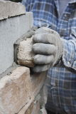 Putting Brick in Place Royalty Free Stock Photography