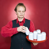 Putting cans on a tray Royalty Free Stock Photos