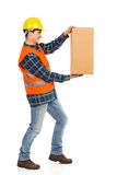 Putting carton box away. Royalty Free Stock Photos