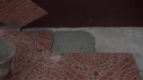 Putting ceramic tile stock video