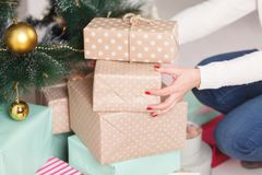 Putting Christmas presents under a tree royalty free stock photo