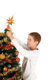 Putting christmas star Royalty Free Stock Images