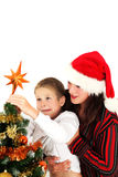 Putting christmas star Stock Photos