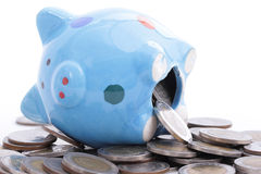 Putting coin to Piggy bank Royalty Free Stock Images