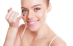 Putting in a contact lens Royalty Free Stock Photography