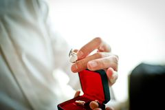 Putting On Cufflinks Royalty Free Stock Image