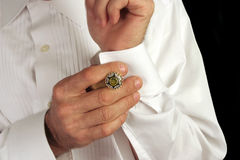 Putting On Cufflinks Royalty Free Stock Photo