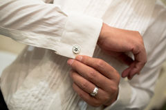 Putting On Cufflinks Stock Photos