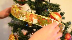 Putting decoartion on Christmas tree, closeup stock video footage