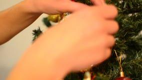Putting decoartion on Christmas tree, closeup stock video