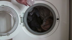 Putting Detergent into the Washing Machine Royalty Free Stock Image