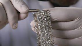 Putting Diamond on a Bracelet stock footage