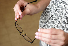 Putting Eye Glasses On Royalty Free Stock Photography
