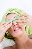 Putting Eye-Pads on eyes Stock Photo
