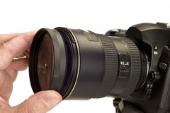 Putting Filter On Camera Lens Stock Photography