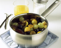 Putting the fruit in a saucepan Royalty Free Stock Photography