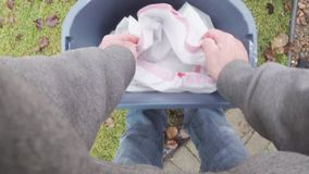 Putting garbage in trash can container. Cleaning up trash dumping it in garbage bin stock video