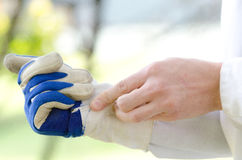 Putting on gardening glove Royalty Free Stock Photo