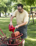 Putting Gas In A Old Garden Tiller Stock Images