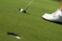 Putting a golf ball Stock Photo
