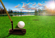 Putting Golf Ball on a Beautiful Golf Course royalty free stock photo