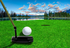 Putting Golf Ball on a Beautiful Golf Course stock photo
