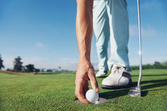 Putting golf man Stock Image