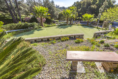 Putting green in Fallbrook home with a bench and palm trees. Outdoors in Southern California homes ready for real estate listings Stock Photo
