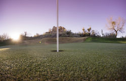 Putting green golf flag sun setting Royalty Free Stock Image
