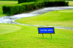 Putting green guidance board in the foreground Stock Photography