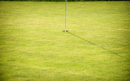Putting green and hole on a golf course Royalty Free Stock Photography