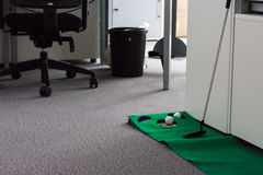 Putting Green in Modern White Office Corporate Fun Entertainment Royalty Free Stock Photo