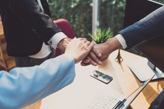 Putting hands of business office partnership royalty free stock photography