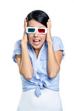 Putting hands on the head girl watching 3D film Royalty Free Stock Image