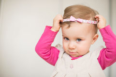 Putting on Head Band Royalty Free Stock Photo