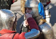 Putting on a helmet Royalty Free Stock Photos