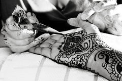 Putting On Henna Royalty Free Stock Image