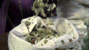 Putting herbs back into the white sack stock footage