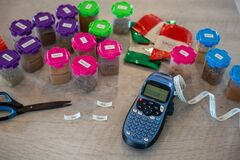 Free Putting Labels On Herb And Spice Containers In A Kitchen, Using A Label Maker Royalty Free Stock Photos - 185446438