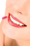 Putting on lip gloss. Woman applying lip gloss, close-up royalty free stock photo