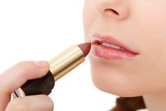 Putting lipstick on Royalty Free Stock Photography