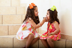 Putting lipstick to each other Royalty Free Stock Images