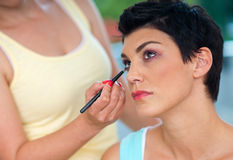 Putting make up Stock Photography