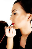 Putting make up on. Royalty Free Stock Photography