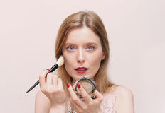 Putting make up Stock Images