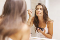 Putting make up on Royalty Free Stock Images