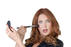 Putting on make up Stock Photo