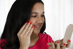 Putting On Makeup Stock Photography