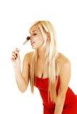 Putting makeup on. Royalty Free Stock Image