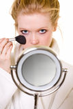 Putting on makeup Stock Photo